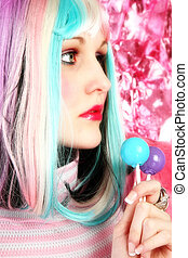 Rainbow - Beautiful young woman in rainbow colored hair with...