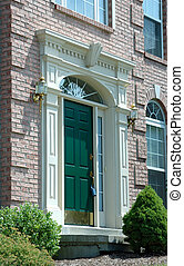 Entry With Lock Box - Front entry door to a large brick home...