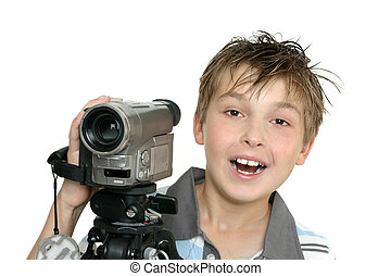 Shooting a video - A child using a video camera and tripod