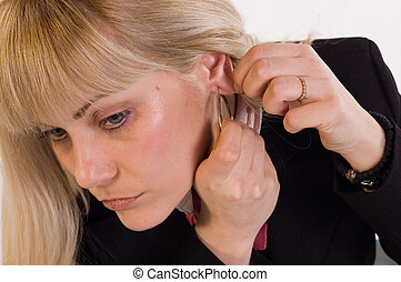 Ear-rings - Young blondie woman putting ear rings on her...