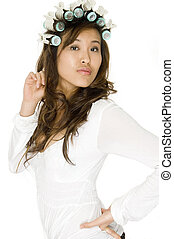 Asian Woman In Rollers - An attractive Asian woman in...