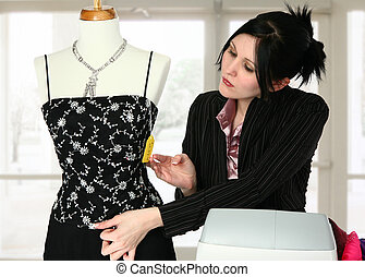 Dress Shop - Beautiful retail sales person adjusting...