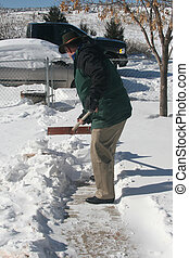 Shoveling Snow - Man shoveling snow off sidewalk
