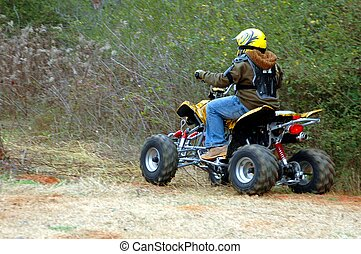 ATV Rider - Photographed atv rider at wooded area in...