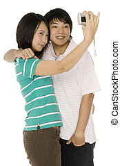 Taking Picture - A young asian couple taking their portrait...