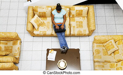 working at home - nice girl working at home and sitting on a...
