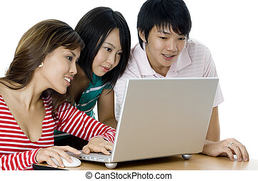 Students Working As Group - Three young asian adults working...