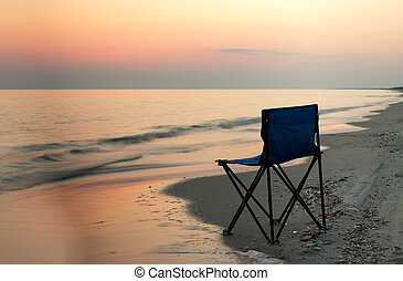 Solitude - Chair standing on the sea cost lightend up with...