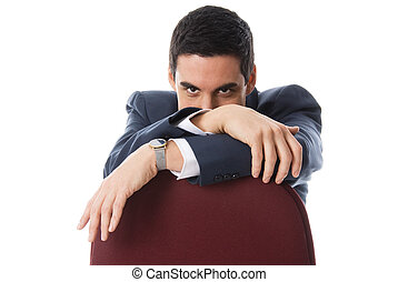 On the chair - man in a blue suit hiding behind a chair