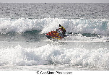Jet Ski - Life saver on a jet ski between waves