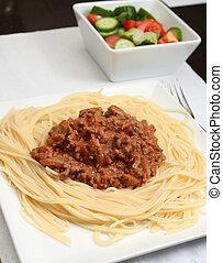 Spaghetti bolognaise - A plate of spaghetti bolognaise on a...