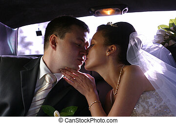 Newly married pair - Kiss of a newly-married couple