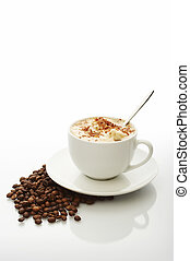 Coffee cup - White cup of cappuccino with coffee beans