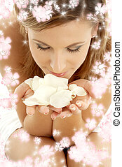 rose petals with small flowers - lovely woman in spa...