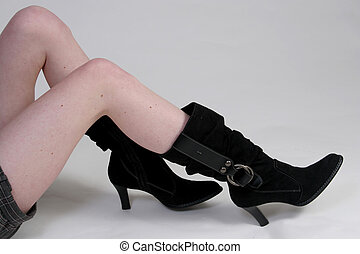 Womans legs, boots - A womans shapely legs in boots with...