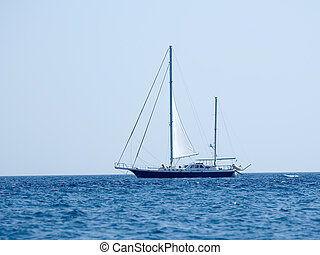 Sailing boat on the open sea