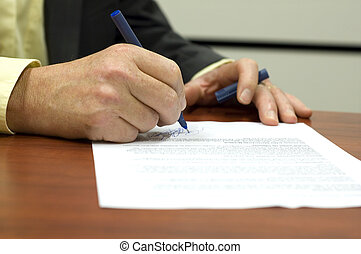 Signing a contract - Business man signing a contract