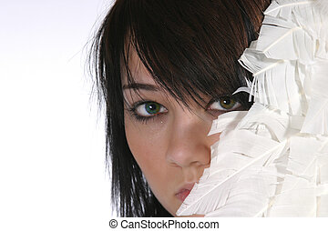 Peekaboo - pretty brunette peeking out from white feathers