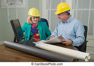 Architect And Client Looking At Blueprints 10