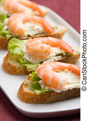 Shrimp toasts - Closeup view of shrimp toasts with salad and...
