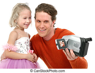 Ballerina - Father and daughter making home videos Daughter...