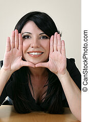 Business framework - Businesswoman with hands framing face.