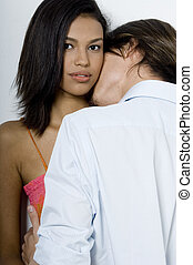 Being Kissed - A pretty young asian woman is kissed by her...