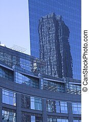 Reflective skyscrape - A skyscraper with reflections of an...