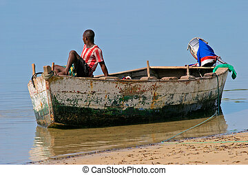 Mozambican fisherman - A mozambican fisherman sitting on a...