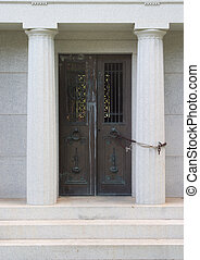 Nobody\\\'s Leaving! - Mausoleum doors chained to a marble...