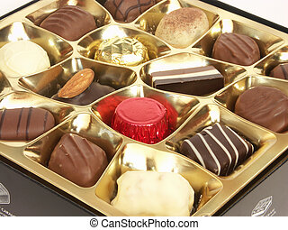 Chocolate Box - A golden dish piled with an assortment of...