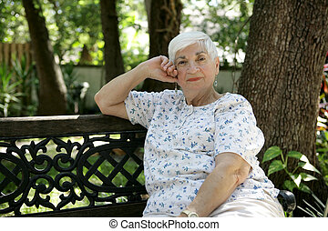 Senior Lady Relaxing in Park
