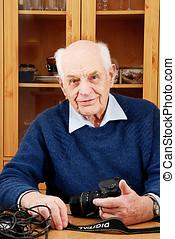 Man senior whit digital SLR camera - Man senior has a hobby...