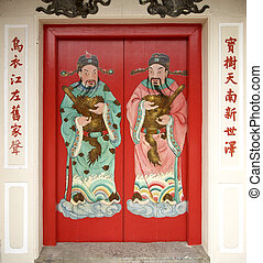 Red Chinese door - Red door at Chinese temple with...