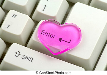 pink heart and enter key, love concept, close up