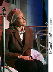 Actress - The actress plays a role, sits on old bed on a...