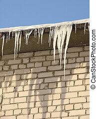 icicles 1 - icicles dangling from the roof of the house