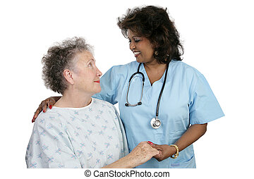 Patient and Nurse - An elderly patient and a caring nurse or...