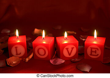 Love shrine with flames - The word LOVE spelt out on...