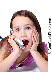 Girl On Cell Phone - A nine year old girl talking on a cell...
