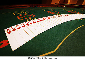 playing cards - Playing cards on a game table in a casino