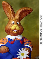 Easter rabbit - Funny sitting easter rabbit with blue...