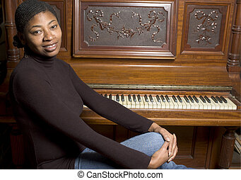 woman in front of old piano