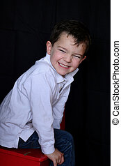 Happy boy leaning  - a cute, happy boy leaning forward