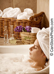 Relaxing - cute woman in a bath in a local spa
