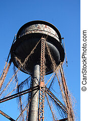 Wateer tower - An old rusted water tower in rural North...