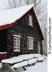 House in the snow - Brown rural home in snowy weather