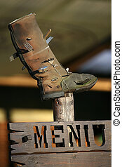 Wooden menu - The wooden menu with old a boot above