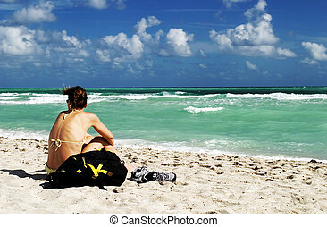Windy day - Young girl wearing bikini at the beach