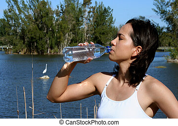 Woman  Drinking Wate - Woman drinking water after a workout